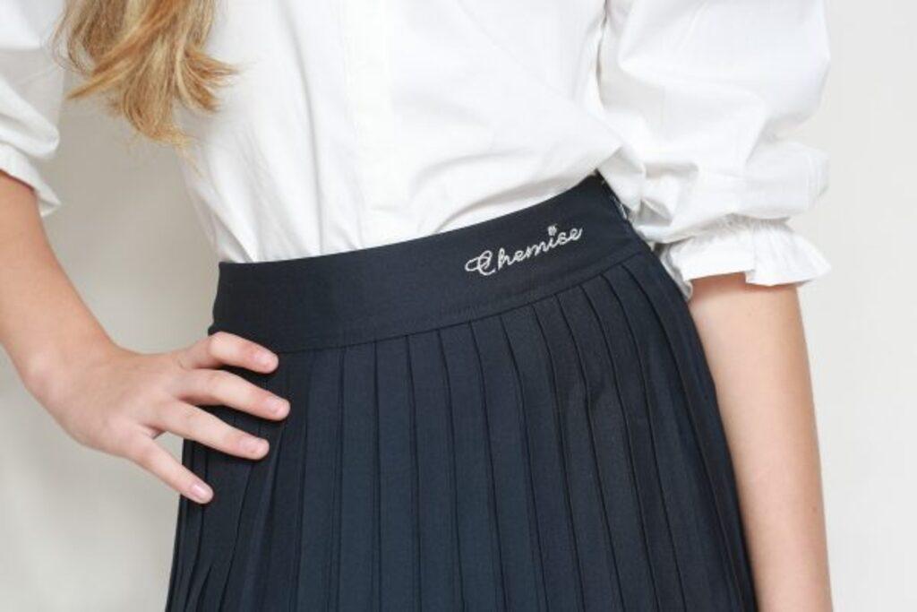 חצאית סקול קפלים רודפים